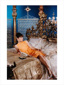 Picture of Audrey reclines on a grandiose bed, Paris When It Sizzles, 1962