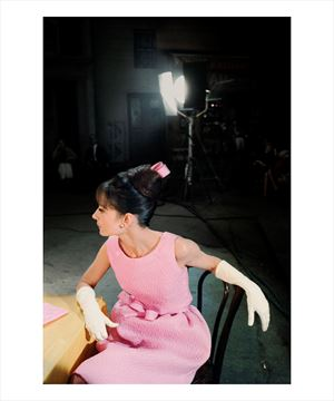 Picture of Audrey wears a pink dress with matching ribbon and elegant white gloves, Paris When It Sizzles, 1962
