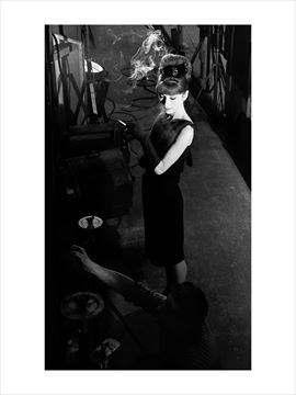 Picture of Audrey waits for a crew member to finish up while shooting photographs for French Vogue, Paris When It Sizzles, 1962