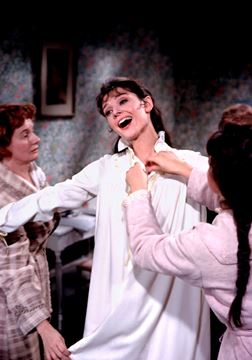 Picture of Eliza continues to sing and dance happily as she is dressed for bed, My Fair Lady, 1963