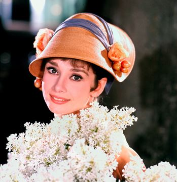 Picture of Audrey poses with white lilacs, My Fair Lady, 1963